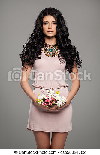 Cute Brunette Woman in Summer Pink Dress with Flowers - csp58024782