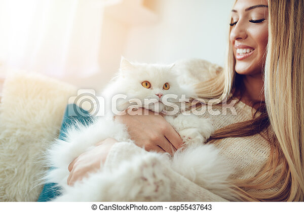 Cute Cat And Girl Beautiful Young Woman Relaxing At Home Embracing Her Beautiful White Persian Cat With Yellow Eyes