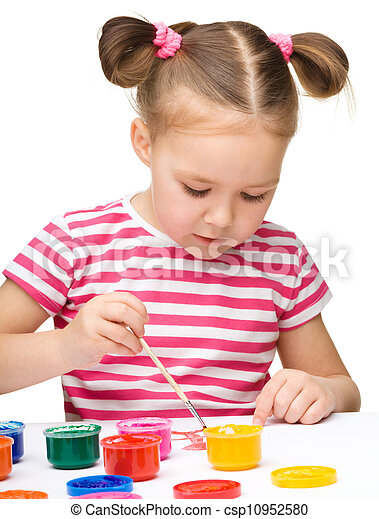 Cute cheerful child play with paints - csp10952580