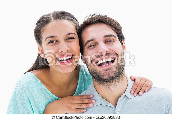 Cute couple smiling at camera - csp20892838