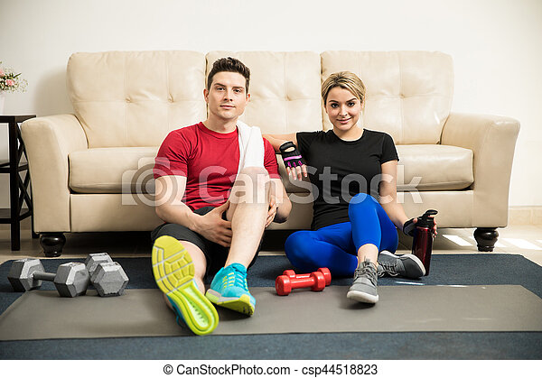Cute couple taking a break from exercising - csp44518823