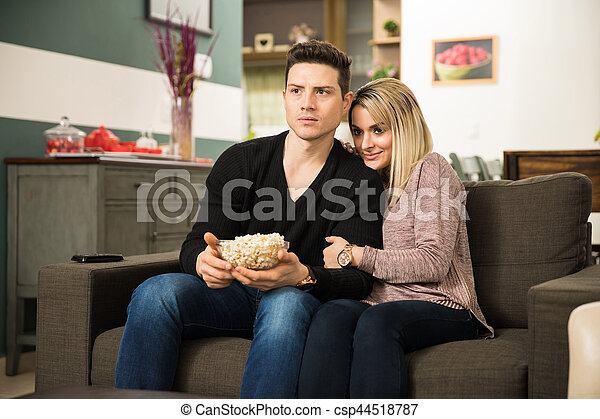 Terrific Cute Couple Watching A Scary Movie Download Free Architecture Designs Scobabritishbridgeorg