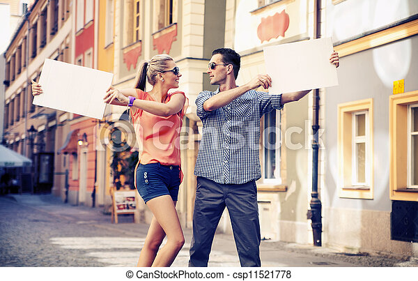 Cute couple with advertise - csp11521778