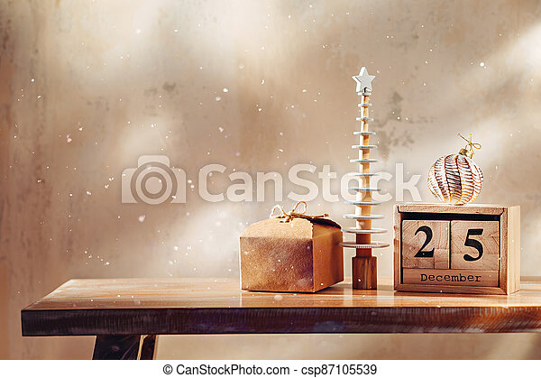 Cute decorative little christmas tree with gift, ornament and wooden block calendar - csp87105539