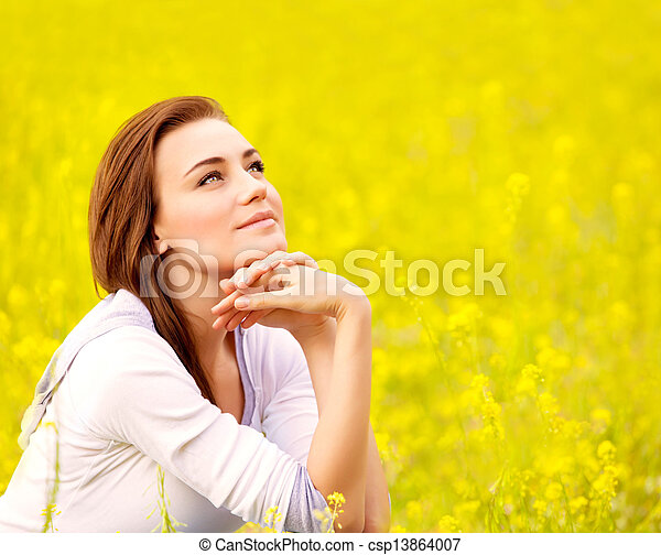 Cute female on yellow floral field - csp13864007