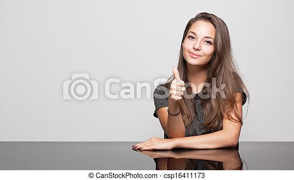 Cute gesturing brunette. - csp16411173