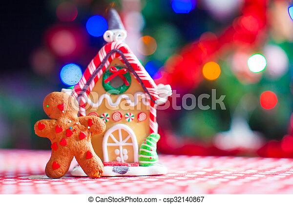 Christmas Gingerbread House Background.Cute Gingerbread Man And Candy Ginger House Background Christmas Tree Lights