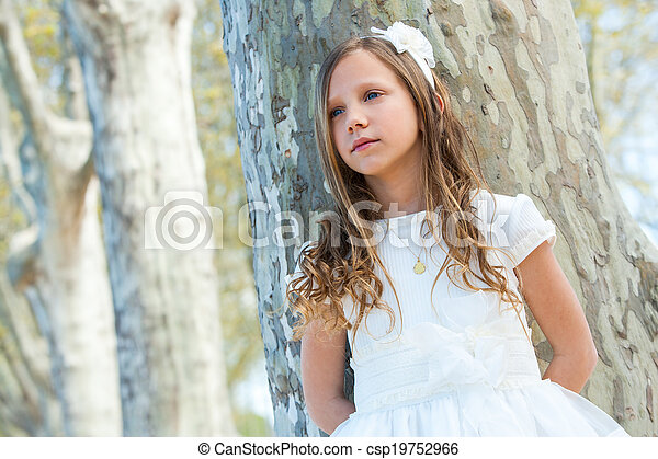 Cute girl in white dress with lost look. - csp19752966