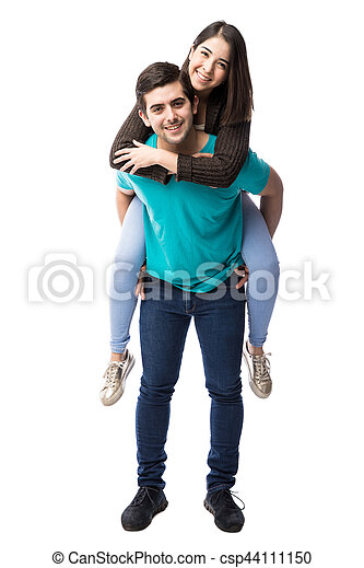 Cute girl piggyback riding on boyfriend