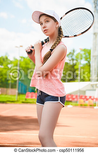 Cute Girl Playing Tennis And Posing In Court Outdoor