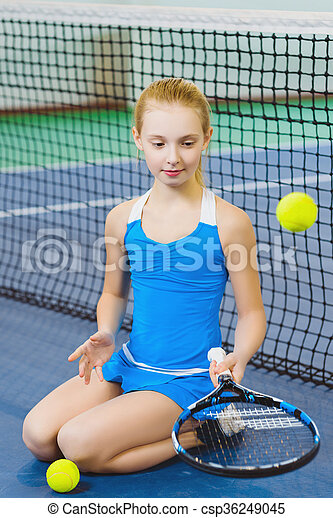 Cute Girl Playing Tennis And Posing In Court Indoor Smiling
