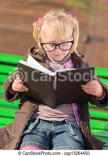 Cute Girl Reading Book - csp13264450