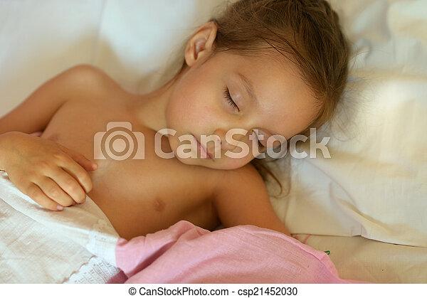 Cute girl sleeping in bed - csp21452030