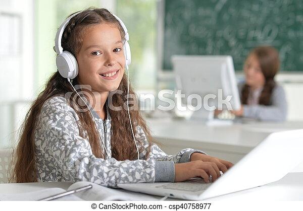 cute girl using laptop computer - csp40758977