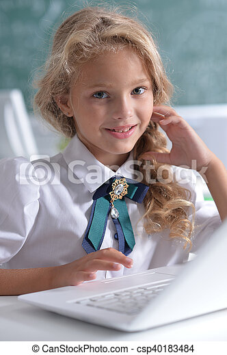cute girl using laptop computer - csp40183484