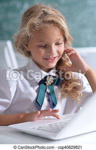 cute girl using laptop computer - csp40629821