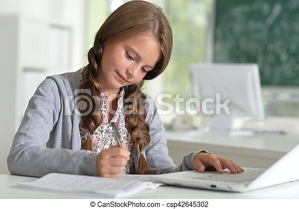 cute girl using laptop computer - csp42645302