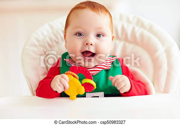 cute happy infant baby boy in elf costume sitting in highchair - csp50983327  sc 1 st  Can Stock Photo & Cute happy infant baby boy in elf costume sitting in highchair.
