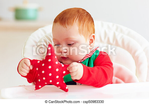 cute infant redhead baby boy in elf costume playing with red star in highchair - csp50983330  sc 1 st  Can Stock Photo & Cute infant redhead baby boy in elf costume playing with red star in ...