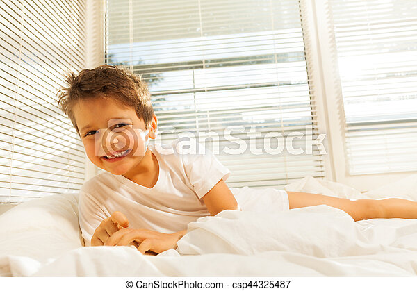 Cute Kid Boy Smiling While Lying On His Bed Portrait Of Cute Kid