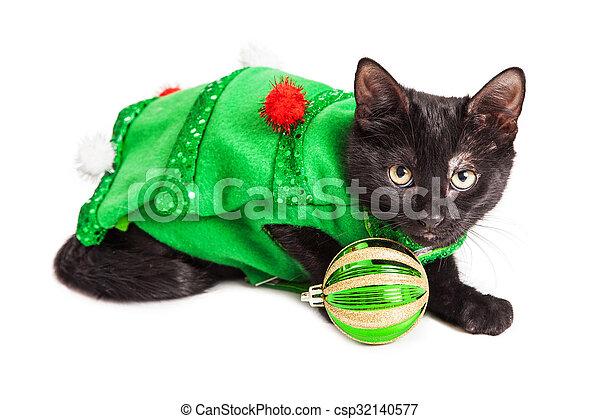 Kitten Christmas.Cute Kitten Wearing Christmas Tree Outfit