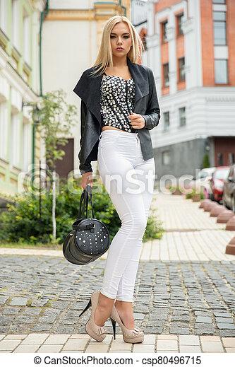 Cute lady posing on the street - csp80496715