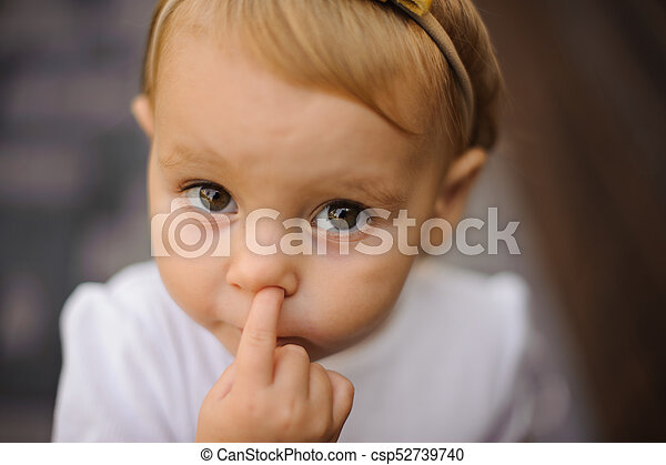Cute little baby girl picking her nose close up cute little baby girl picking her nose csp52739740 voltagebd Choice Image