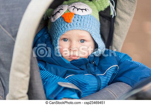 Cute little baby in a stroller - csp23469451