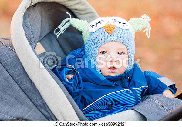 Cute little baby in a stroller - csp30992421