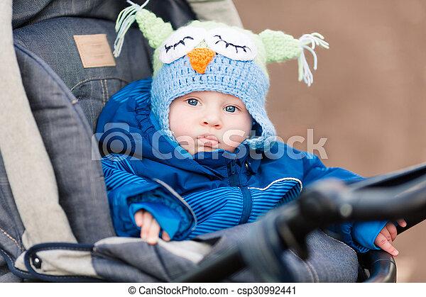 Cute little baby in a stroller - csp30992441