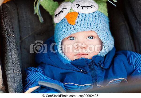 Cute little baby in a stroller - csp30992438