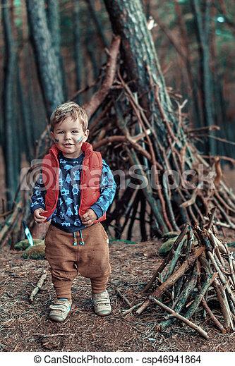 Cute little boy building a wooden hut - csp46941864