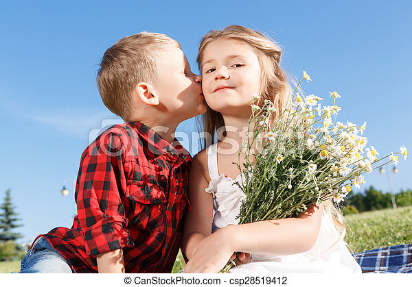 Cute little boy kissing girl puppy love positive little boy cute little boy kissing girl csp28519412 altavistaventures Images