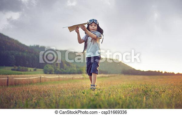 Cute little boy playing toy plane - csp31669336