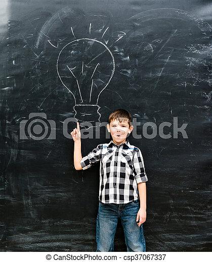 cute little boy with finger up having an idea - csp37067337
