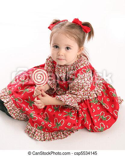 0ed5279e942b8 Cute little girl in christmas wear. Adorable toddler girl wearing a ...