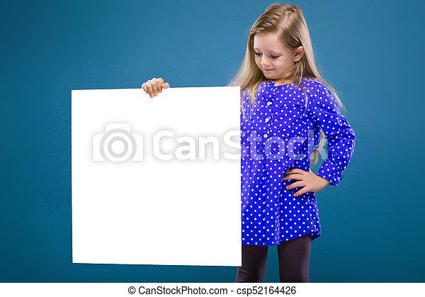 Cute little girl in purple dress holds empty poster - csp52164426