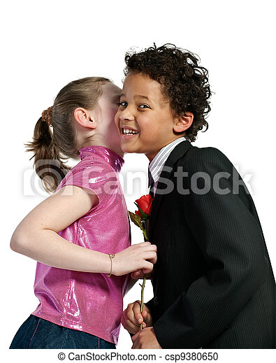 Cute Little Girl Kissing A Boy Isolated On White Background