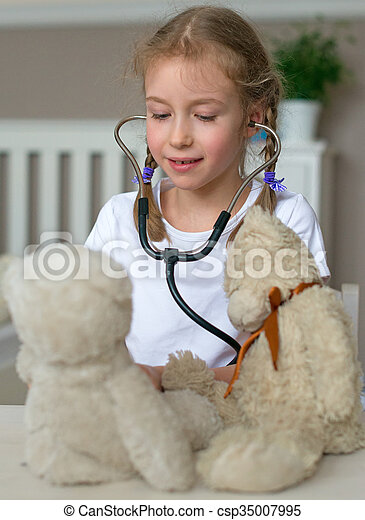 Cute little girl playing in doctor with her toys. - csp35007995