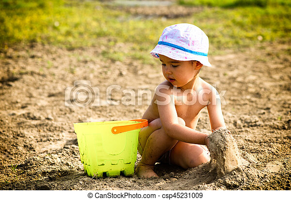 Cute little girl playing with sand - csp45231009
