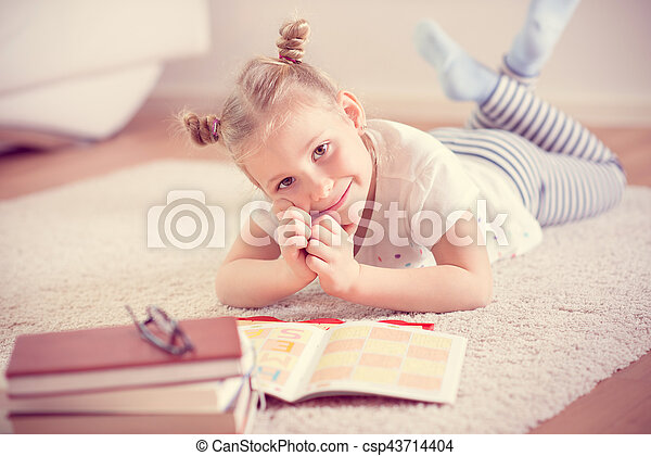 Cute Little Girl Read Book At Home