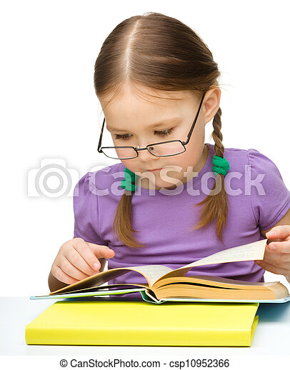 Cute little girl reading book wearing glasses - csp10952366