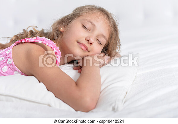 Cute Little Girl Sleeping In A Bed