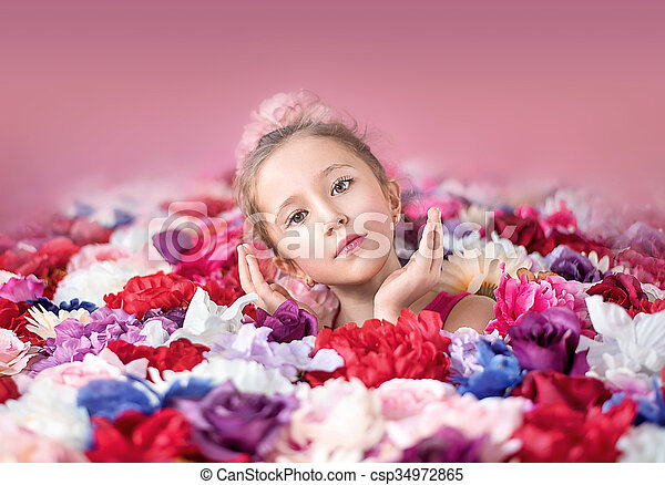 Cute little girl with a bunch of flowers - csp34972865