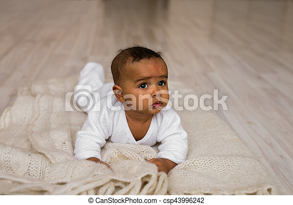 Cute Mixed Race African American Baby Boy Plays On Bed   Csp43996242
