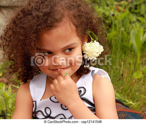 cute mixed race girl with timid expression stock photo