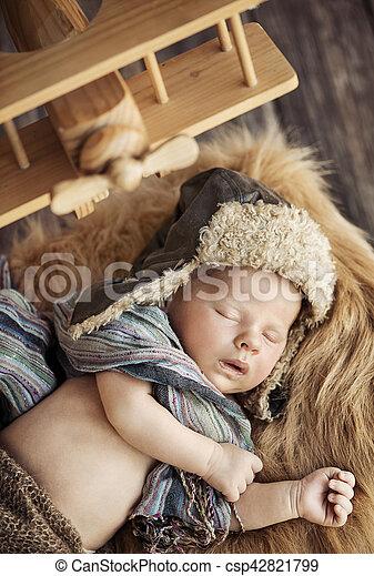 Cute newborn baby dressed as a pilot - csp42821799