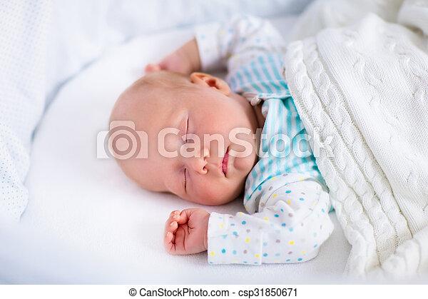 Cute Newborn Baby In White Bed Newborn Baby Boy In Bed New Born Child Sleeping Under A White Knitted Blanket Children