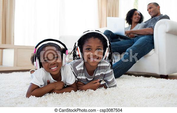 Cute siblings listening music - csp3087504