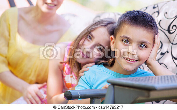 Cute siblings posing with their mother - csp14793217